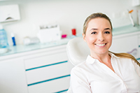 eNL woman smiling at dental office  patient  operatory